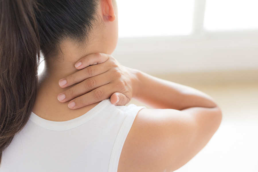 Woman rubbing neck pain area